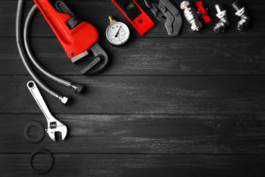 plumber tools on background